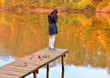 unhappy young girl in front of the fall landscape