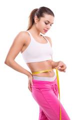 Weight losing - measuring beautiful woman's body