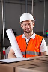Handsome engineer in factory