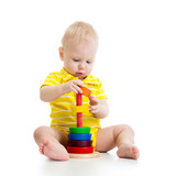baby boy playing with pyramid toy