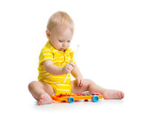 Nice baby playing  with musical toys