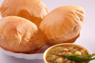 Puri bhaji-An Indian dish made up of puri and aloo bhaji.
