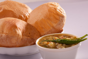 Puri bhaji-An Indian dish made up of puri and aloo bhaji.