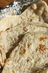 Naan - a round flatbread made of white flour & laced with butter