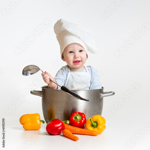 cook baby sitting inside pan with healthy food