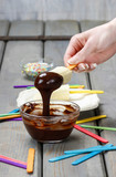 Preparing chocolate dipped banas dessert