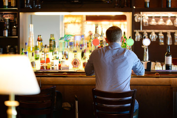 Lonely man at bar