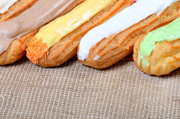 Eclair with a cream on a plate