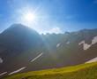 sparkle sun above a mountain pass