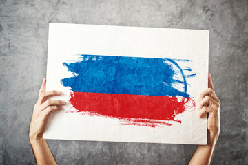 Russia flag. Man holding banner with Russian Flag.