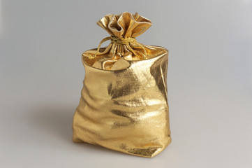Filled gold sack on gray