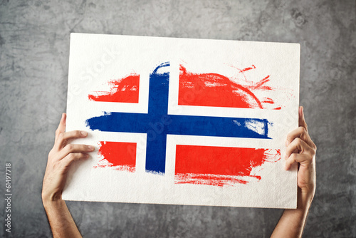 Norway flag. Man holding banner with Norwegian Flag.