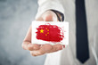 Chinese Businessman holding business card with China Flag