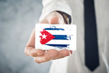 Cuban Businessman holding business card with Cuba Flag