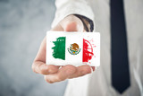 Mexican Businessman holding business card with Mexico Flag