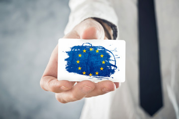 European Businessman holding business card with EU Flag