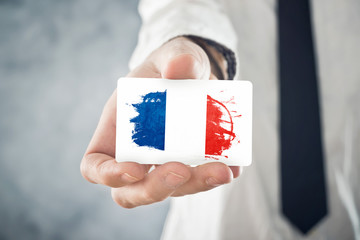French Businessman holding business card with  France Flag