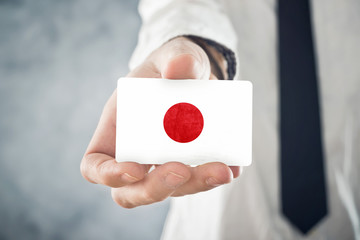 Japanese Businessman holding business card with Japan Flag