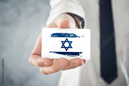 Israelian Businessman holding business card with Israel Flag