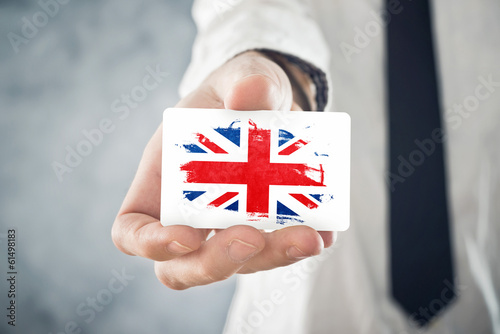 British Businessman holding business card with Great Britain Fla