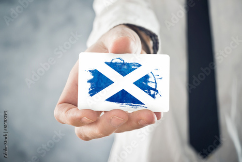 Scotish Businessman holding business card with Scotland Flag