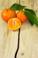 Tangerines on wooden background.