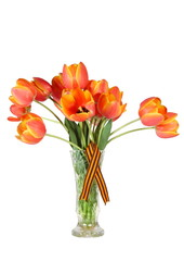 Isolated red tulips bouquet in crystal flower vase with a George