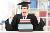 Excited student giving thumbs up behind stack of books