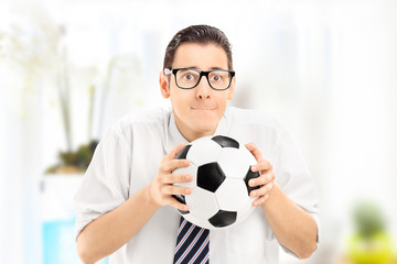 Anxious young sports fan watching football match