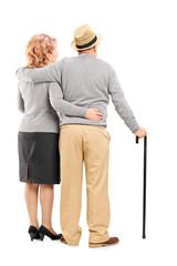 Studio shot of a happy senior couple hugging, rear view