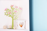 Decorative tree with  bows, on shelf, on blue wall background