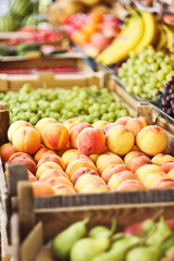 Various fresh fruits in boxes on the market