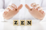 Man holding protective hands above the word Zen