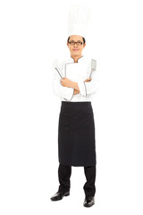 professional chef in white uniform and tools
