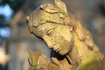 Stone Girl on Tomb from old Prague Cemetery, Czech Republic