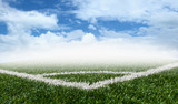 Corner soccer green grass field with blue sky white clouds backg