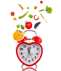 Clock in shape of heart with vegetables.