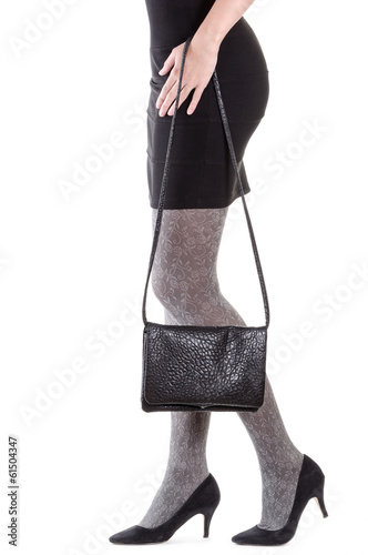 Woman legs with bag