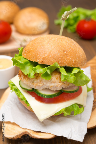 homemade chicken burger with vegetables, cheese