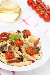 pasta with sausage, cherry tomatoes and olives