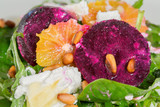 Fresh salad with roasted beetroot, goat cheese, orangeand pine n