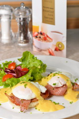 Eggs Benedict- toasted English muffins, ham, poached eggs