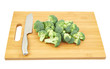 broccoli pieces over a cutting board