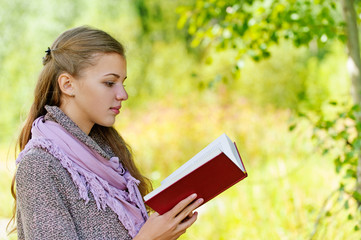 beautiful woman reading red book
