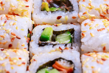 Macro photo of avocado roll with sesame
