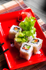 Vegitable roll on red plate
