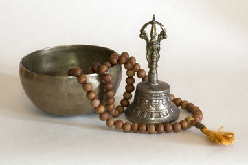Singing bowls with prayer beads and bell