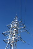 High-voltage transmission tower against a blue sky
