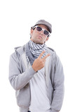 cool man in gray sweatshirt wearing sunglasses and cap with scar