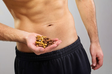 Closeup of young man holding organic nuts